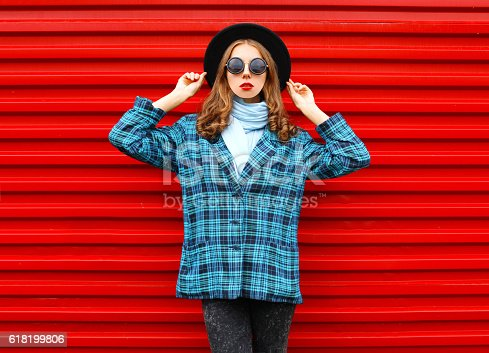 istock Fashion pretty woman wearing black hat coat jacket over red 618199806