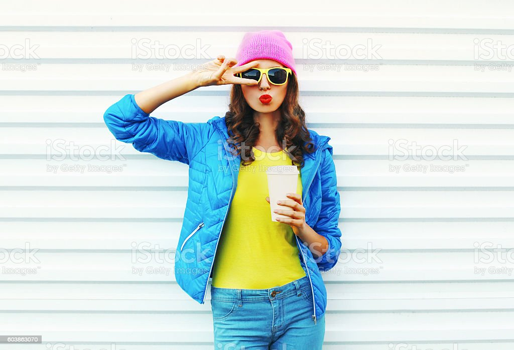 Fashion pretty woman with coffee cup in colorful clothes stock photo