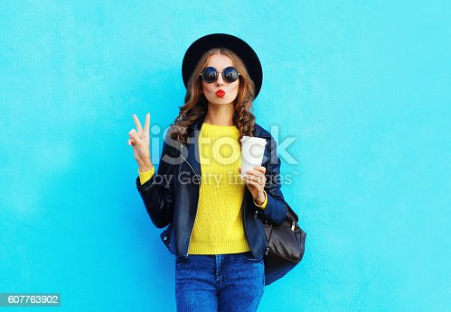 istock Fashion pretty woman with coffee cup wearing black rock style 607763902