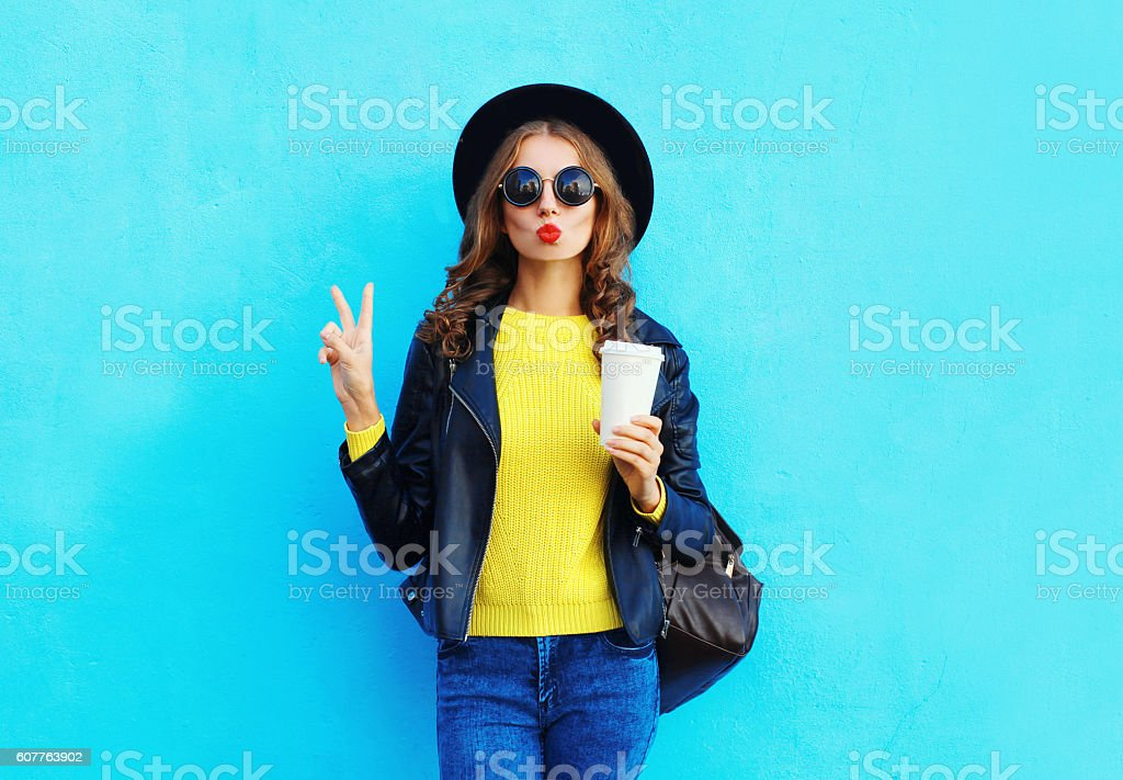 Fashion pretty woman with coffee cup wearing black rock style - foto de acervo