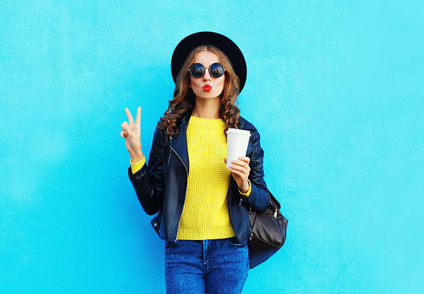 fashion pretty woman with coffee cup wearing black rock style - hipster persona foto e immagini stock