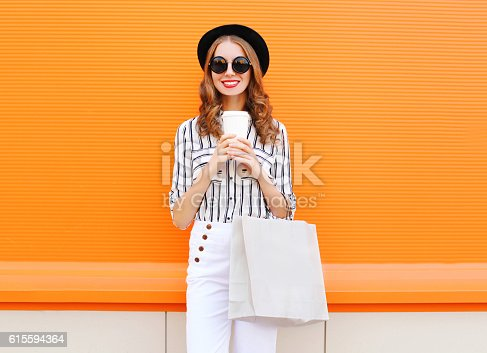 istock Fashion pretty young smiling woman model, shopping bag, coffee cup 615594364