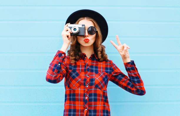 Fashion pretty young woman blowing red lips with retro camera wearing picture id641006232?b=1&k=6&m=641006232&s=612x612&w=0&h=zyo7xl inrfh9a4jkifi dbwejvdxmwjvvmoty 4dyk=