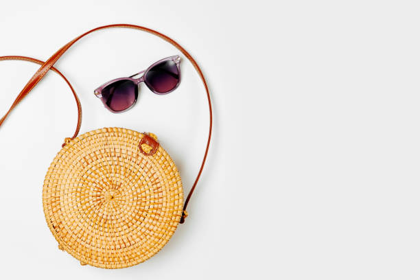 Fashion round bamboo bag and sunglass. Flat lay, top view. Spring/summer fashion concept. stock photo