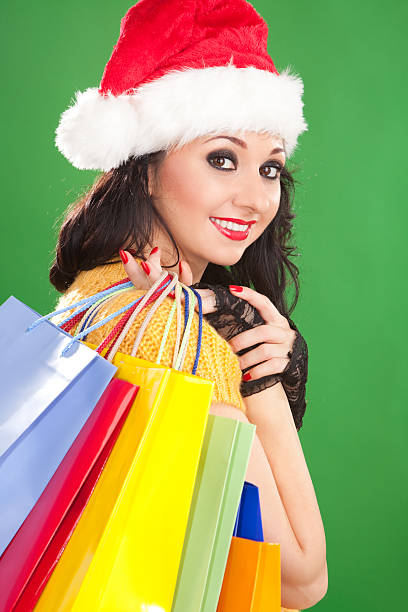 Fashion santa woman with color packages stock photo