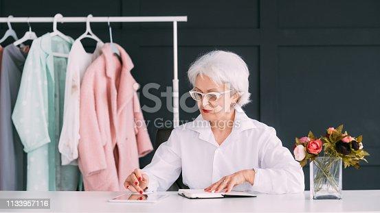 1133515238 istock photo fashion senior lady stylist successful business 1133957116