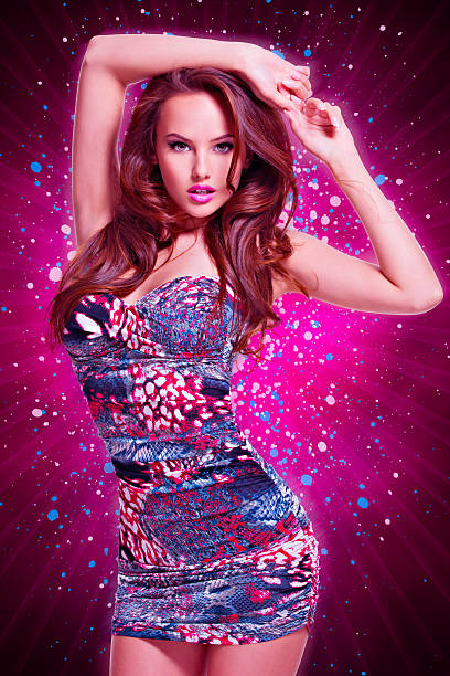 Fashion sexy model in mini skirt over creative background stock photo