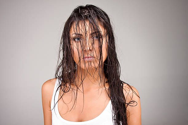 Fashion shoot of a young woman  wet hair stock pictures, royalty-free photos & images