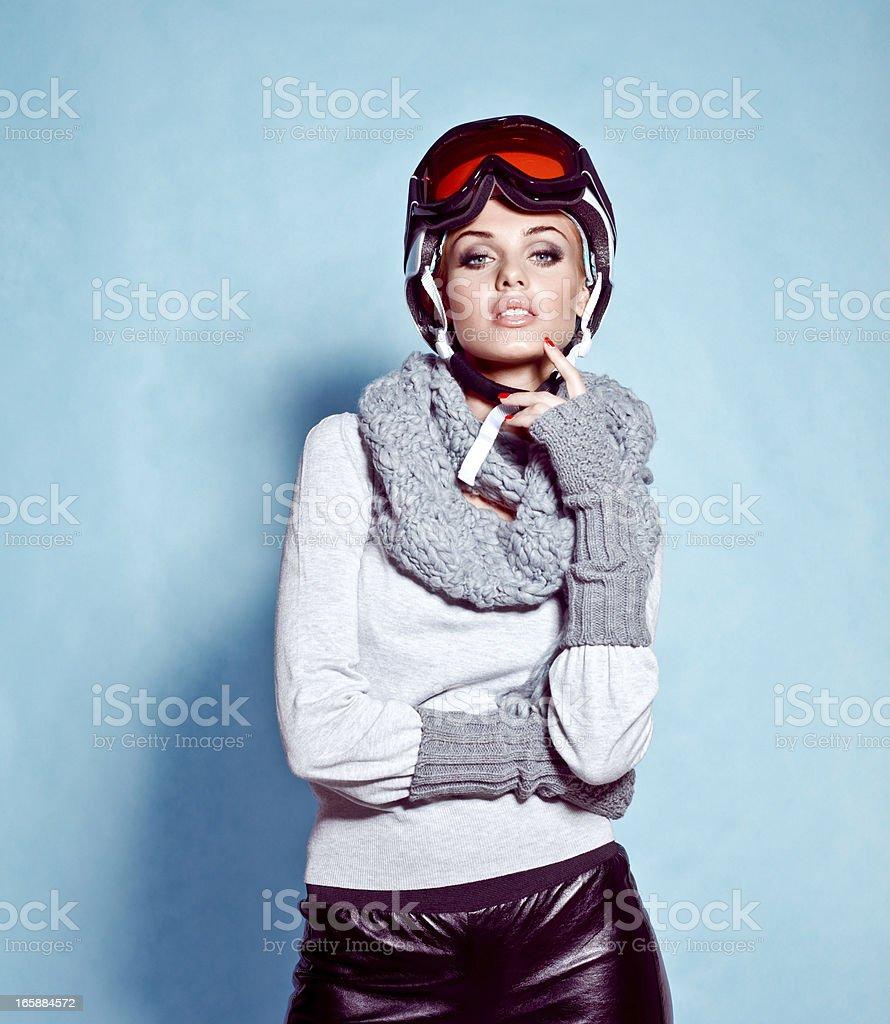 Fashion shot of young woman in winter ski gear stock photo