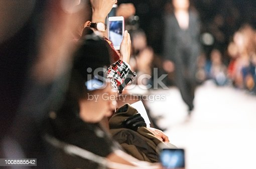 Using smart phone to film fashion show