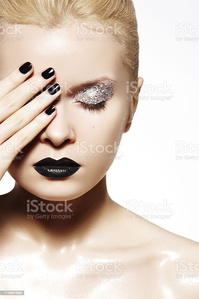 Fashion silver make-up. Shiny wet skin, black lips and nails stock photo