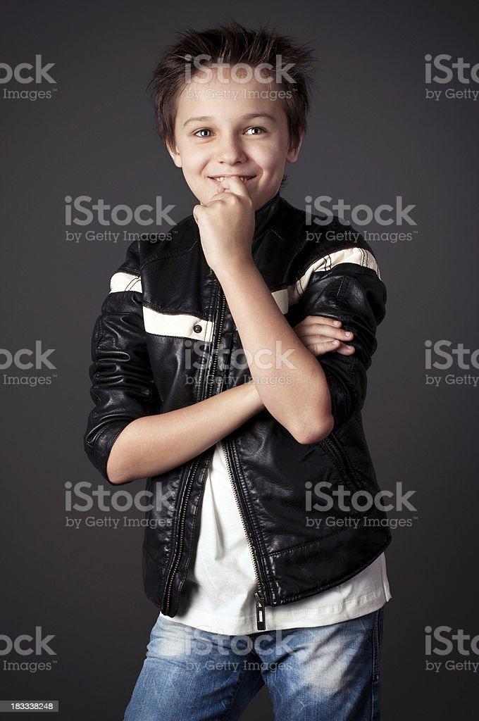 Fashion studio portrait of a cute boy stock photo
