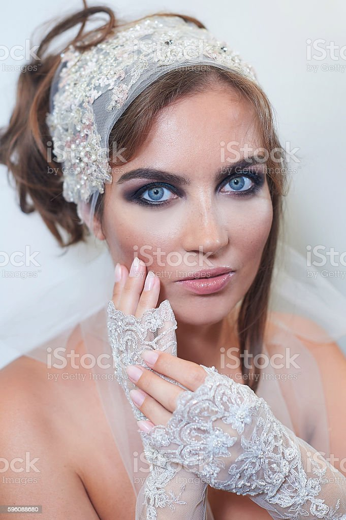 fashion studio portrait of beautiful young bride with make up royalty-free stock photo