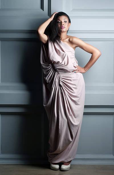 Fashion studio shot of young model in dress stock photo