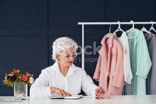 1133515238 istock photo fashion style assistance woman senior business 1132787358