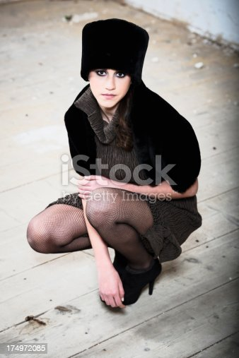 Fashion style portrait of young girl. Added high contraste.