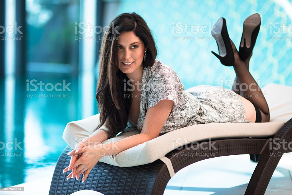 fashion styling pose of a woman in boudoir lingerie look stock photo