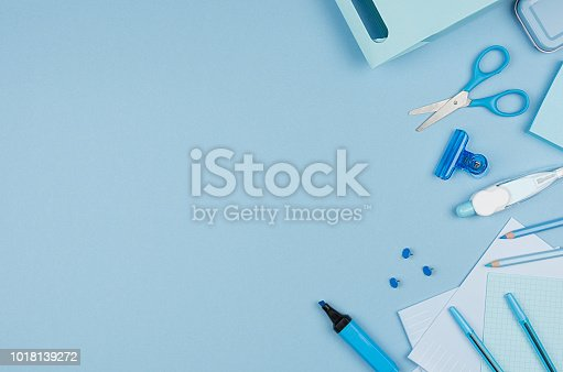 istock Fashion stylish workplace -  neon blue office stationery collection on pastel background, top view, copy space. 1018139272