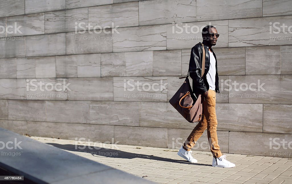 Fashion stylish young african man in city stock photo