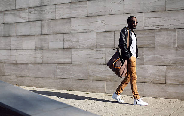 fashion stylish young african man in city - urban fashion stock photos and pictures