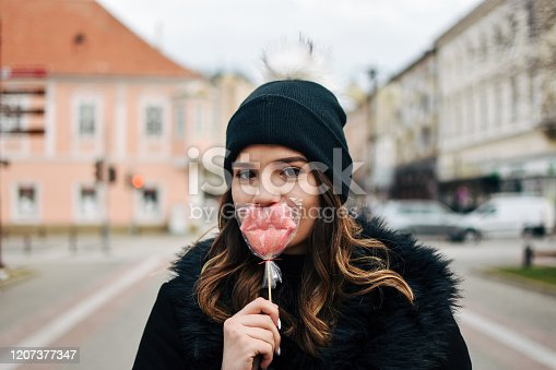 529664088 istock photo Fashion sweet woman having fun with lollipop 1207377347