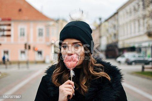529664088 istock photo Fashion sweet woman having fun with lollipop 1207377357