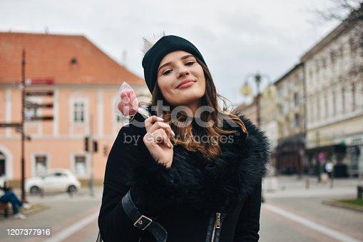 529664088 istock photo Fashion sweet woman having fun with lollipop 1207377916