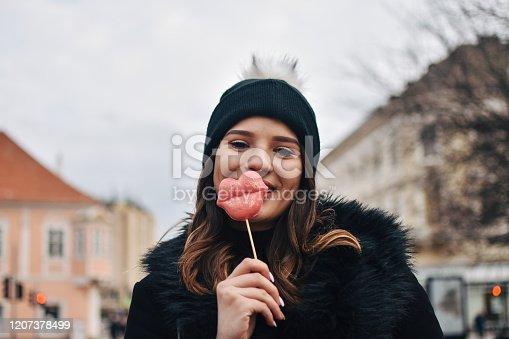 529664088 istock photo Fashion sweet woman having fun with lollipop 1207378499