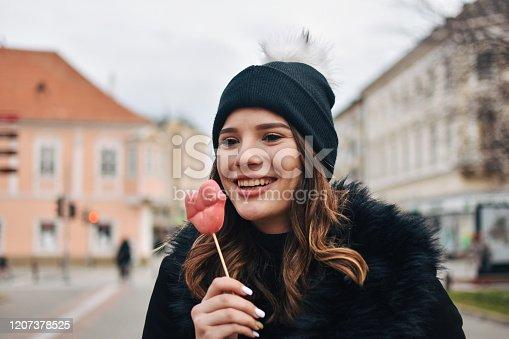 529664088 istock photo Fashion sweet woman having fun with lollipop 1207378525