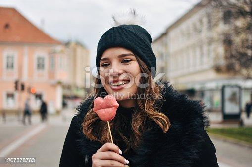 529664088 istock photo Fashion sweet woman having fun with lollipop 1207378763