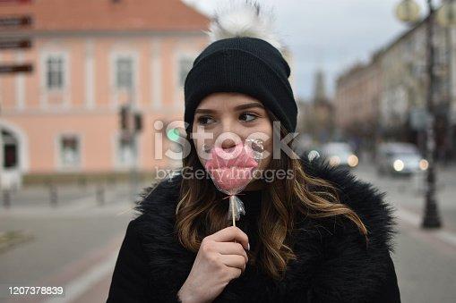 529664088 istock photo Fashion sweet woman having fun with lollipop 1207378839