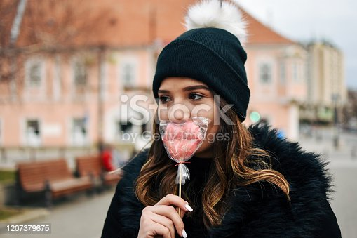 529664088 istock photo Fashion sweet woman having fun with lollipop 1207379675