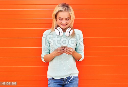 istock Fashion, technology and people concept - pretty smiling girl usi 481061886
