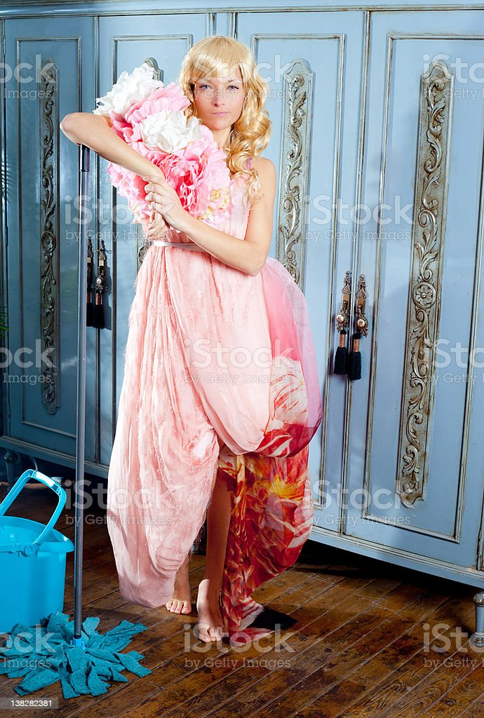 fashion vintage blond housewife cleaning mop chores royalty-free stock photo