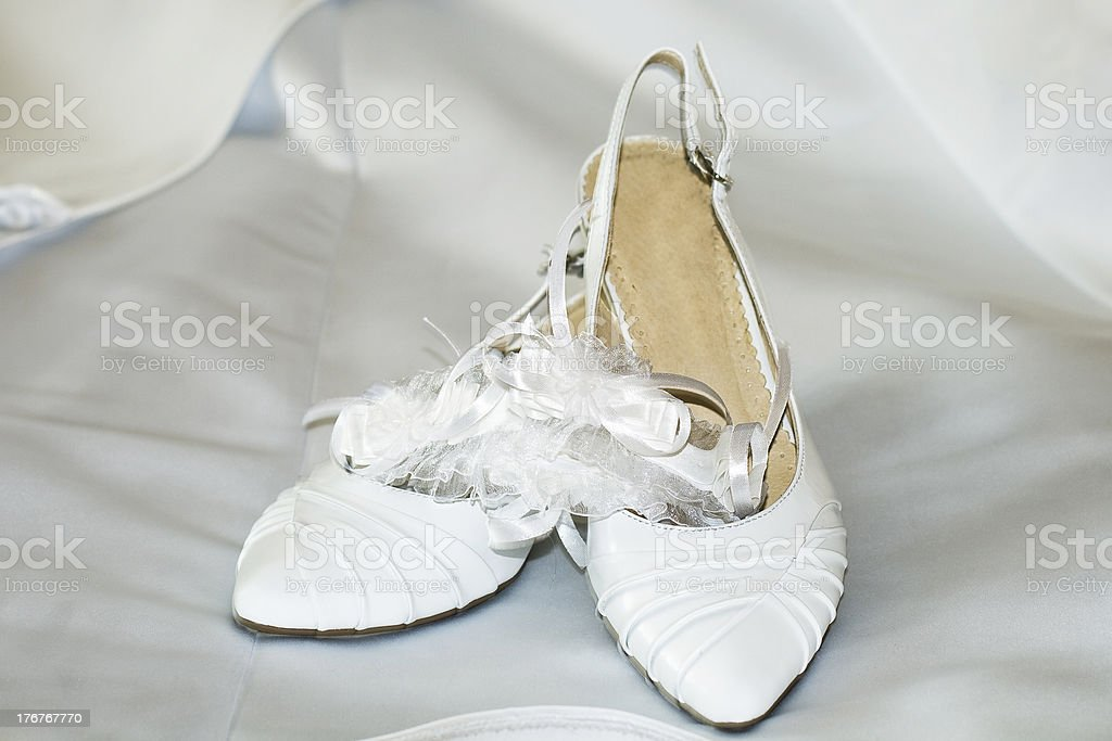 Fashion wedding shoes for the bride over background royalty-free stock photo