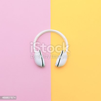 istock Fashion white headphones on vanilla background. Urban summer tim 468807874