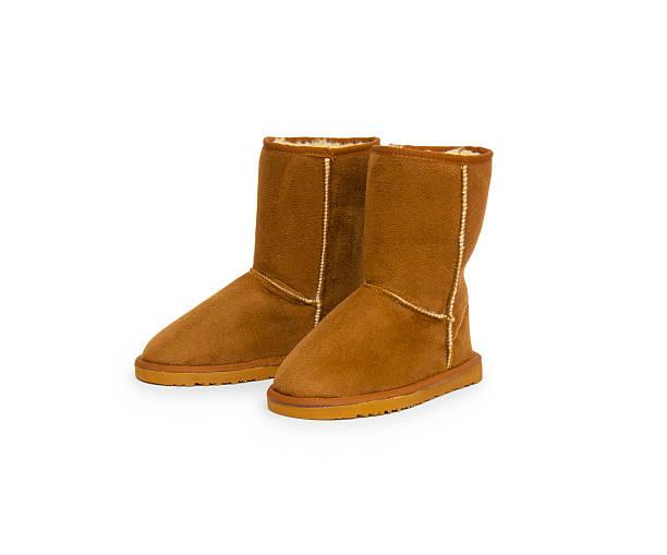 mode winter boots - lammfellstiefel stock-fotos und bilder