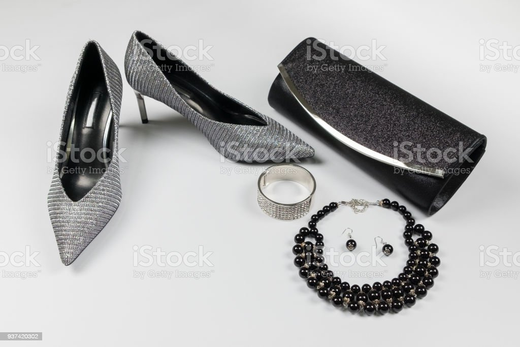 97a591e787 Fashion woman accessories set. Trendy Collection of black and silver, shoes  heels, handbag clutch, necklace on white background - Stock image .