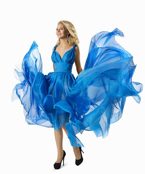 fashion woman blue dress flying fabric, elegant girl waving gown - abendkleid lang blau stock-fotos und bilder