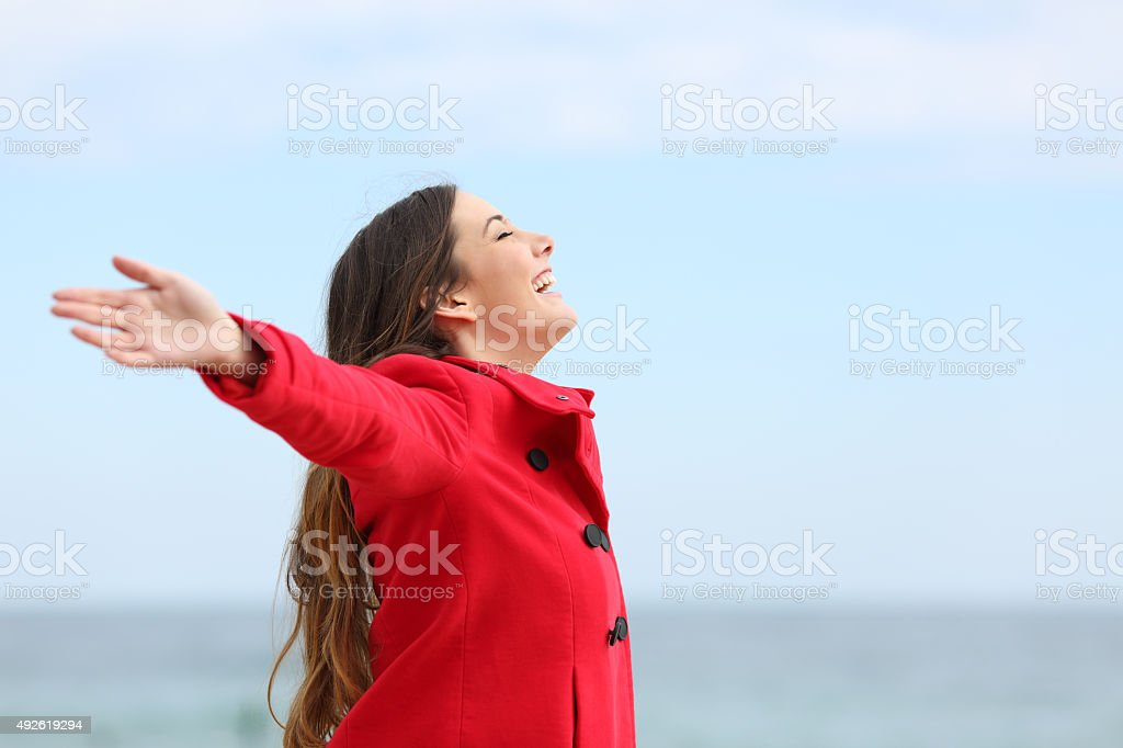 Fashion woman breathing deep fresh air in winter stock photo