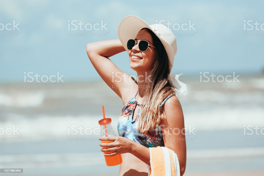 Fashion woman drinking cocktail on the beach royalty-free stock photo