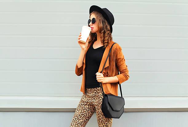 Fashion woman drinks coffee cup wearing elegant hat jacket handbag picture id595358438?b=1&k=6&m=595358438&s=612x612&w=0&h=p02 csaanws2vfaovkzoablzg52fjr9 cikbkvwh4yu=
