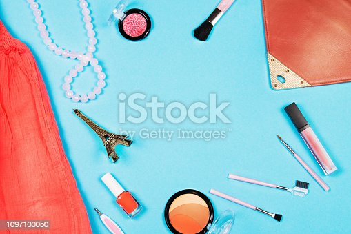 1078252326 istock photo Fashion woman essentials on blue background, Top view 1097100050