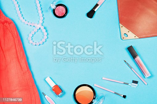 1078252326 istock photo Fashion woman essentials on blue background, Top view 1127846739