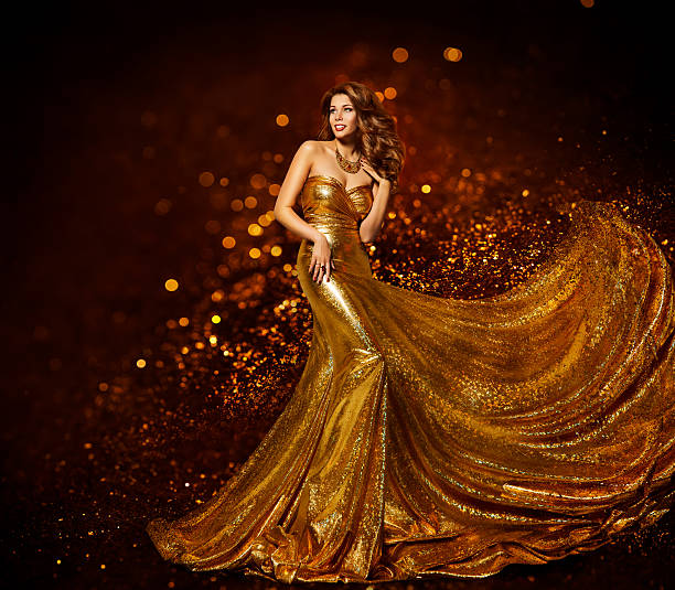fashion woman gold dress, girl elegant golden fabric gown - glamour stock photos and pictures