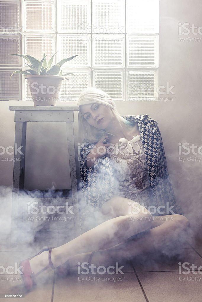 Fashion woman in a smoky area royalty-free stock photo