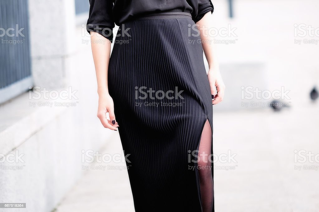 Fashion woman in black pleated dress stock photo
