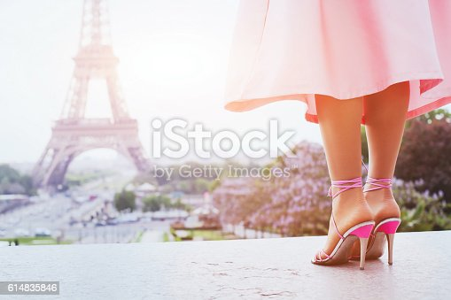 istock fashion woman in Paris, shoes on high heels 614835846