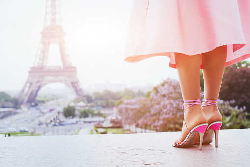 578573556 istock photo fashion woman in Paris, shoes on high heels 614835846
