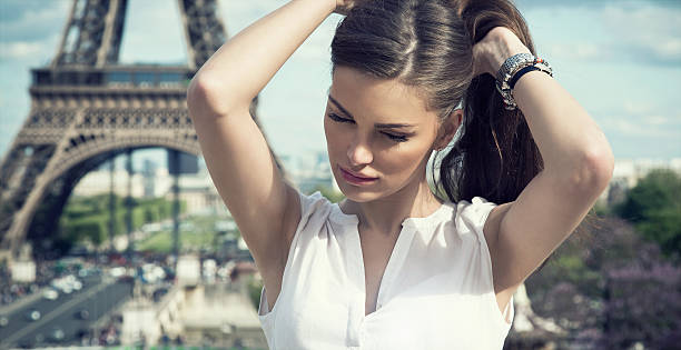 fashion woman in romantic city - paris fashion stock photos and pictures